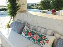 Cosy couch cushions with sea and island views
