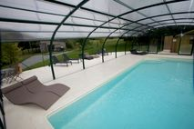 Heated swimming pool with UV protected cover