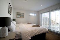 Ground floor annexe - second double bedroom with patio doors to walled courtyard