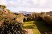View from main bedroom over rear garden and sea views