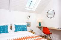 The master bedroom has a  kingsize bed and an en-suite shower room and electric velux windows