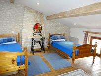 The triple room is in the grenier (hayloft) and overlooks the garden