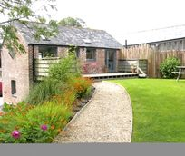 The Red Barn exterior.  Upstairs opens onto a large terrace and a huge garden beyond