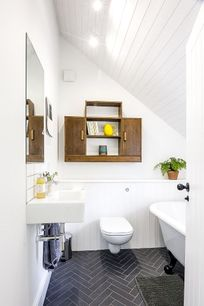 The family bathroom with roll top bath