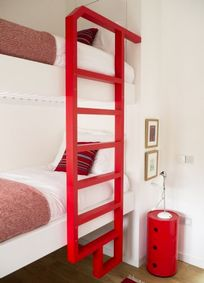 The fun bunk room has full size single beds