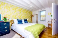 The downstairs bedroom has a kingsize bed and an en-suite shower room