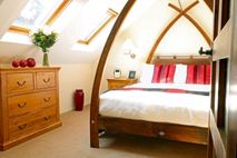 Four poster bed in the main bedroom