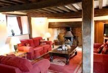 Cosy lounge with log burner.