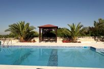 Shaded seating area by solar heated pool with spectacular views