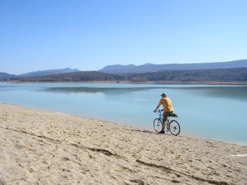 Sandy beaches & turquoise blue waters of Lake Montbel, 5km, the wild swimming is a treat