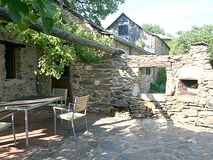 The sunny, sheltered terrace of the cottage is perfect for alfresco meals.