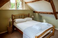Main bedroom with handcrafted eco ash kingsize bed