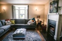 Family sitting room with open fire