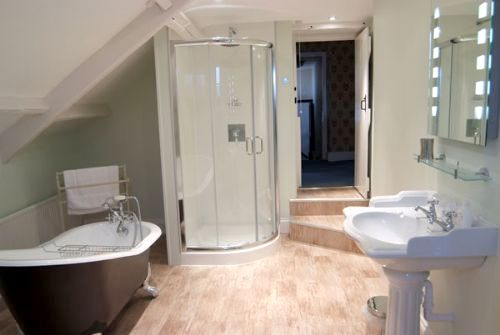 One of the 3 bathrooms, complete with roll-top bath