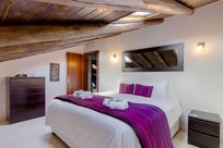 Purple room with roof shutters