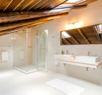 Spacious showers in all bathrooms, double basins in family bathroom.