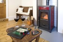 The Snug with wood burning stove
