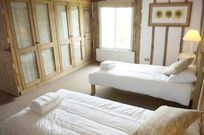 Main twin bedroom overlooking pond with ample cupboards
