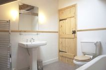 Upstairs bathroom with bath shower