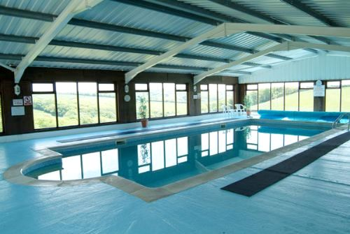 Large indoor heated swimming with amazing countryside views