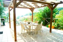 The Gubbio terrace with shade, loungers and a gas BBQ