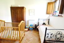 The single room with a cot & toys