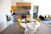 The fully fitted kitchen with toaster, microwave, oven, gas hob, coffee machine & dishwasher