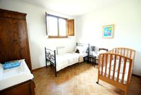 The single room has a cot and a single bed