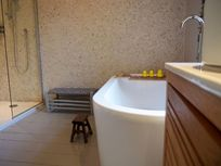 Relaxing master bathroom with wetroom shower to side of view