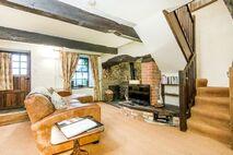 Ivy sitting room with log burner