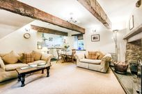 Lavender sitting room with log burner