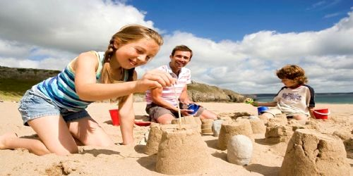 Making sand castles on local beach