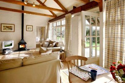 Family Friendly Holidays at Glynn Barton Cottages - Bull Run (Sleeps 4 + Cot)