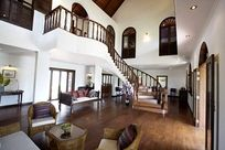Teak flooring and furniture throughout the house