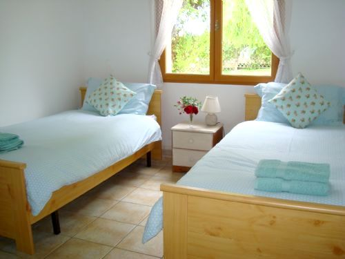 Light and airy twin room overlooking the gardens.