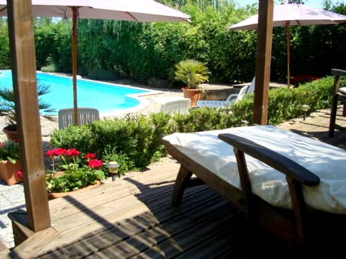 12m x 6m fenced and alarmed pool with raised sun deck and plenty of shade