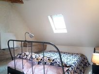 Upstairs is a light & airy, dual aspect loft space bedroom - one double bed, one single and a cot