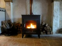 Real fire, perfect for relaxing on Autumn evenings. There are electric radiators in bedroom & shower room