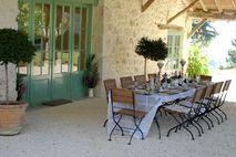 Outdoor dining  under the cool veranda at Lartigue