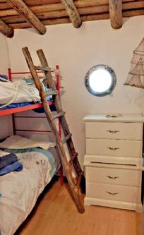 Nautically themed bunk bed room with ships port hole a separate cot is available