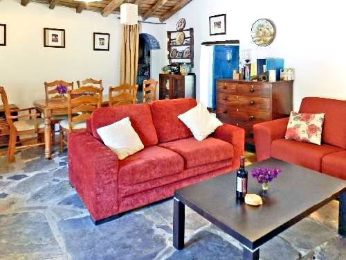 Large living and dining room with satellite television and lots of DVDs