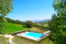 The spectacular swimming pool with heated splash pool & slide