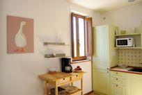 The kitchen with coffee machine, microwave & dishwasher