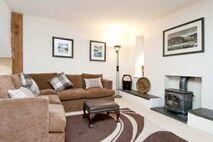 Ty Hen living room with log burner