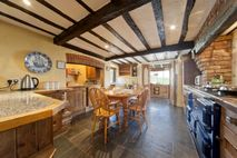 Traditional farmhouse kitchen complete with 4 oven aga for those budding masterchefs