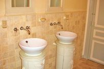 One of the 2 bathrooms with twin sinks