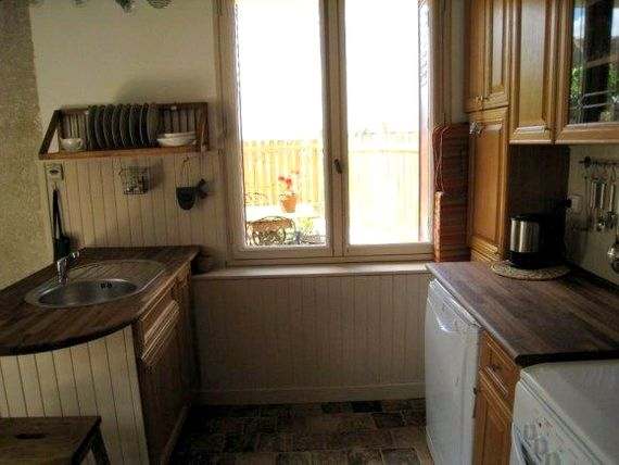 Kitchen view of private terrasse...window makes a good serving hatch!