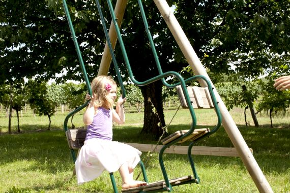 Enjoy the swings, sandpit, trampoline, tree house and slackline in the garden