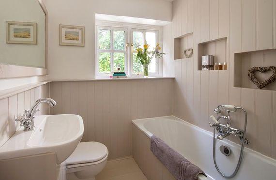 Downstairs bathroom with bath