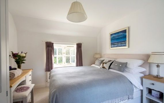 Master bedroom with bespoke hand painted furniture